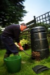 man using compost bin